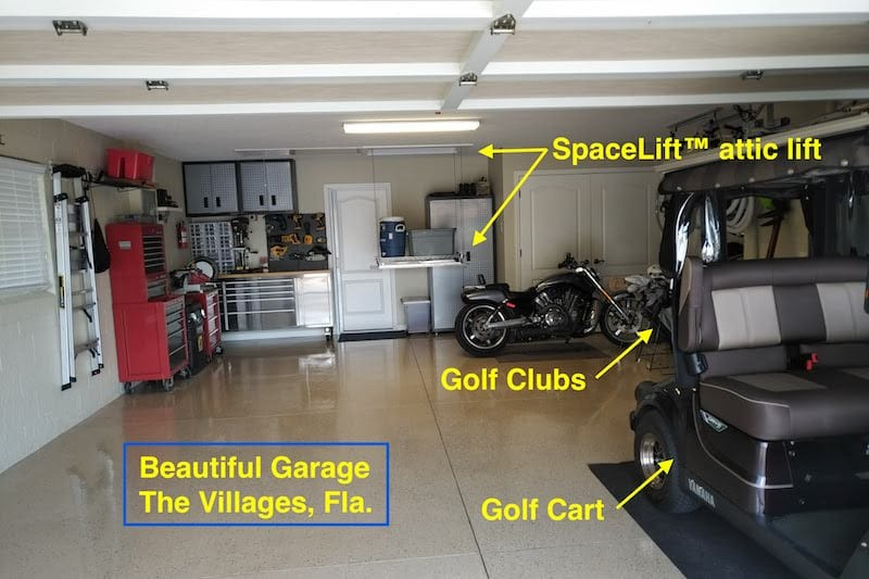 SpaceLift attic lift in The Villages retirement community. Shows lift, golf cart and motorcycle.