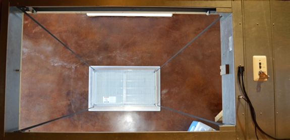 attic lifts make attic storage safe and convenient, photo shows SpaceLift attic lift from attic perspective looking down