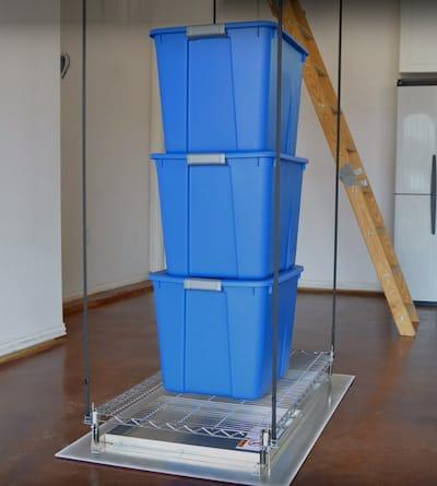 three plastic storage bins stacked on SpaceLift attic lift