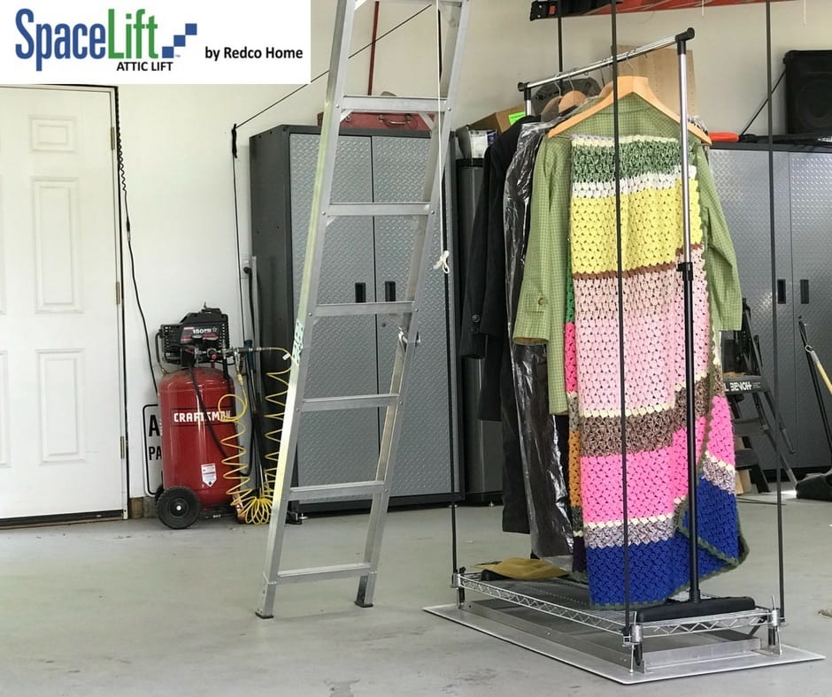 shows portable wardrobe with winter clothing being carried in and out of the attic on a SpaceLift attic storage lift.