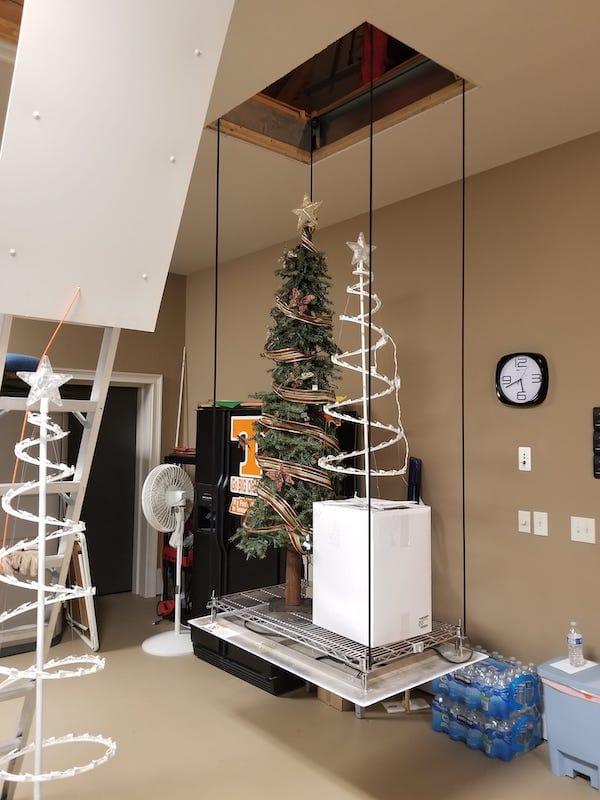 attic lift or attic elevators carrying tall Christmas decorations