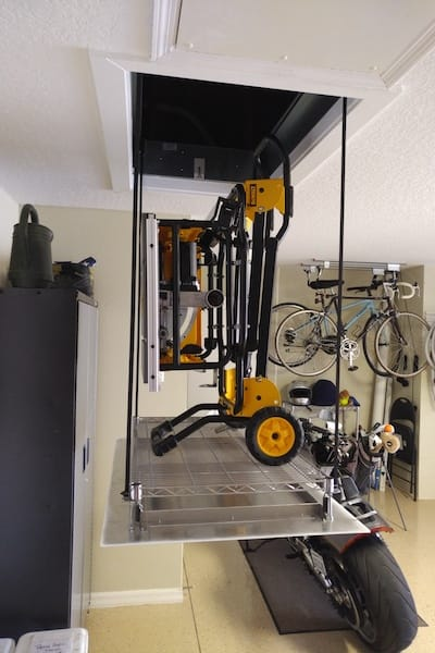 do it yourself SpaceLift attic install shown lifting heavy table saw