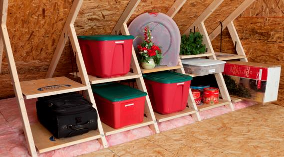 plastic storage containers stored between attic trusses